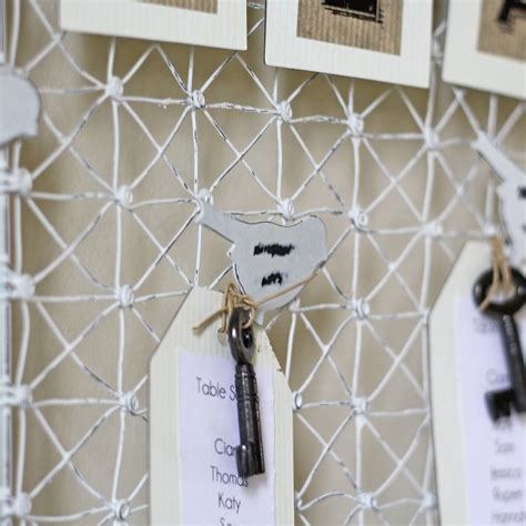 Distressed Wire Table Plan With Bird Pegs By The Wedding